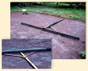 Scrap wood rake for lawn leveling